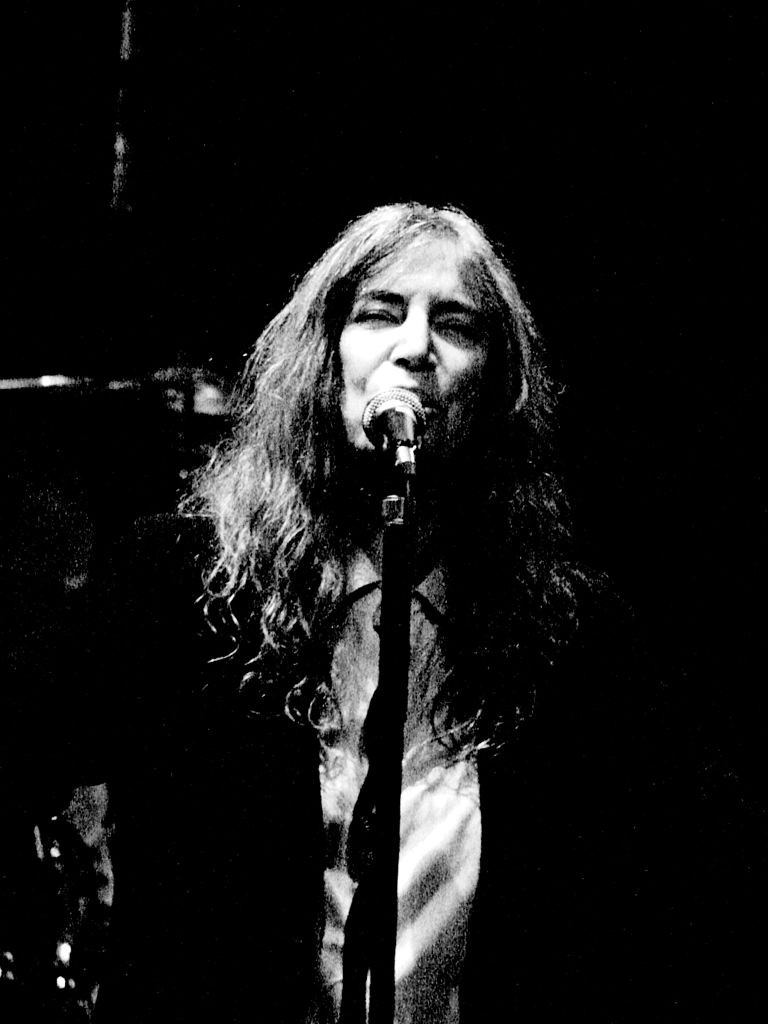Patti Smith performing at The Roundhouse, London, 2007. Photo by Fabio Venni from Florence (originally posted to Flickr as Patti Smith) [CC BY-SA 2.0 (http://creativecommons.org/licenses/by-sa/2.0)], via Wikimedia Commons